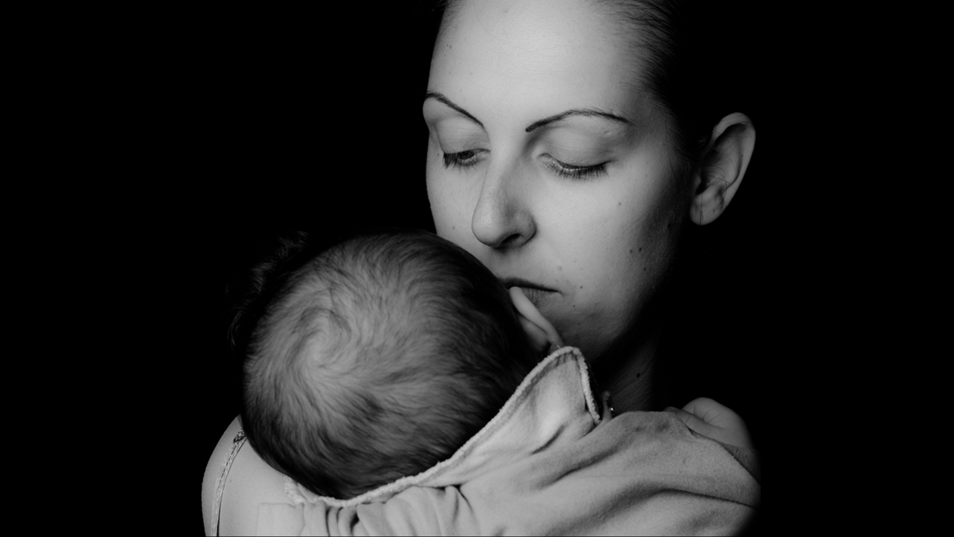 woman-holding-baby