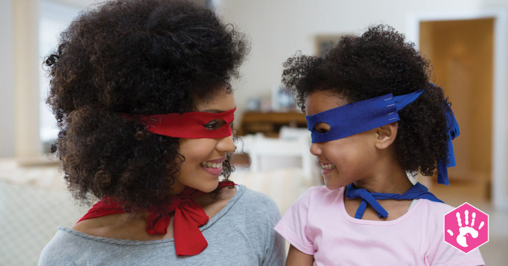 mother and daughter with superhero masks